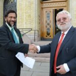 """Oslo last week, outside the Norwegian Parliament building: Svein Tveitdal delivers the """"Concerned Grandparent Statement"""" to Rajendra Pachauri."""